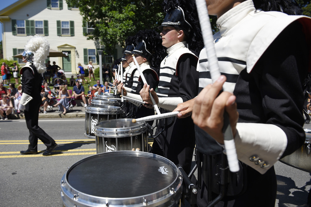 Members of the Spartans Drum and Bugle Corps. perform during Chelmsford's 49th annual Fourth of July parade on Monday, July 4, 2016.