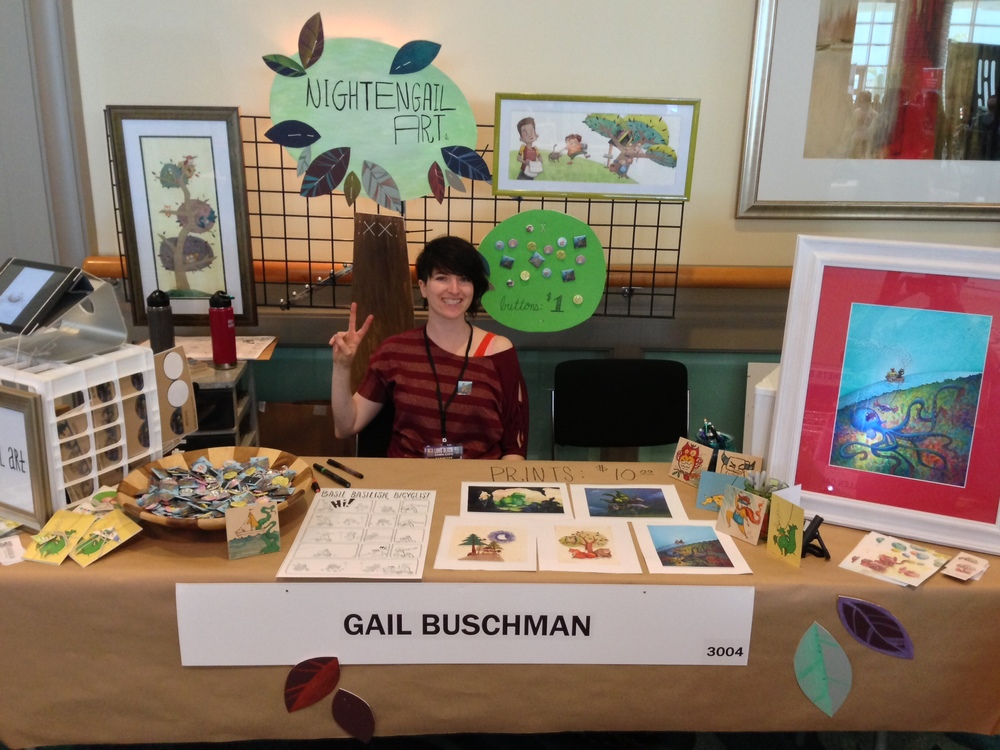 Me at my table. On the white crate sat an ipad with a rotating portfolio of my work.