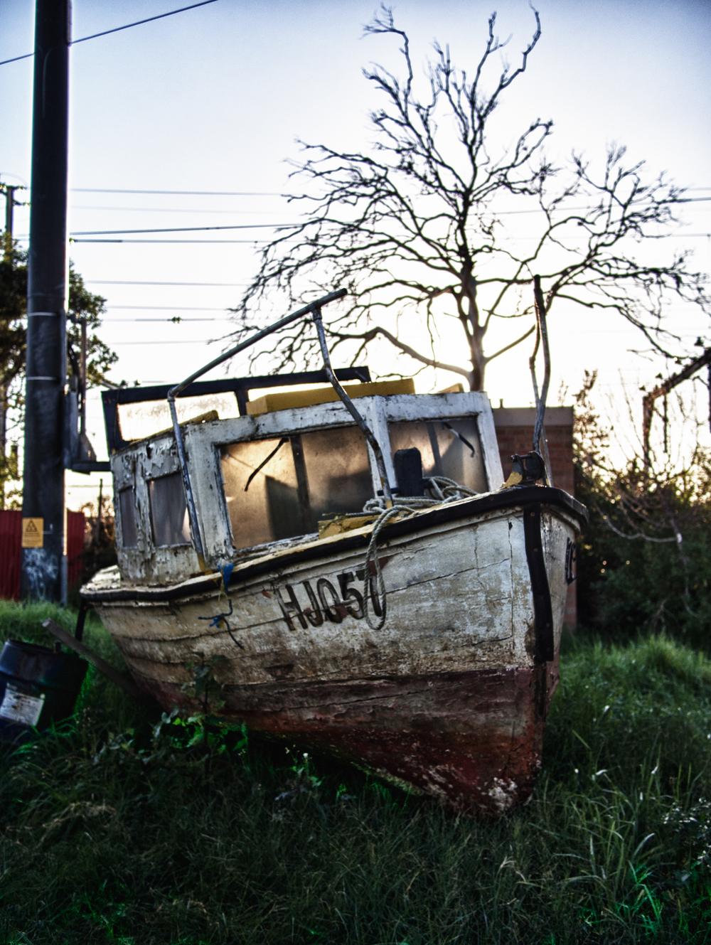 Title: Glow.  Little boat along the Mordialloc creek.