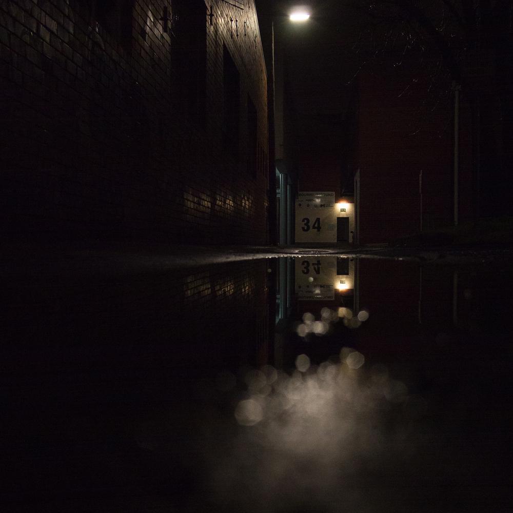 A walk along a dark street after the rain...