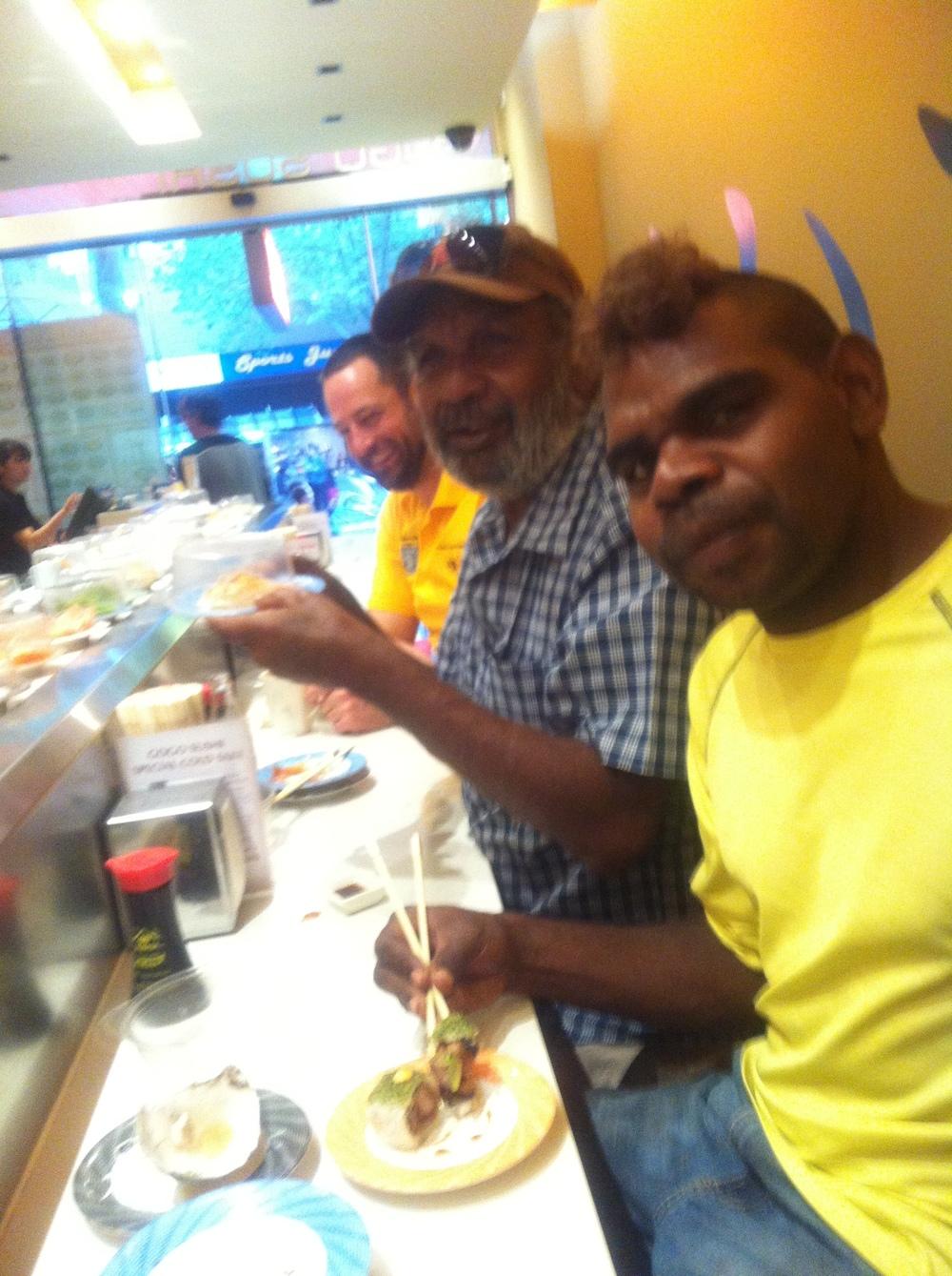 Sid and Mathew enjoy sushi train in Melbourne