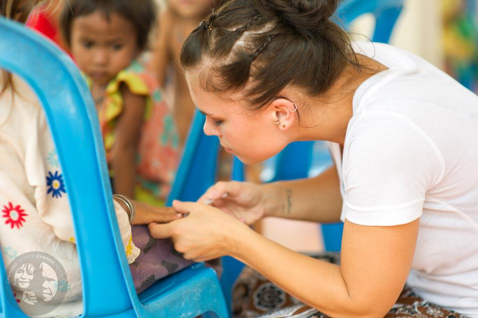 Clipping nails at a children's program about hygiene