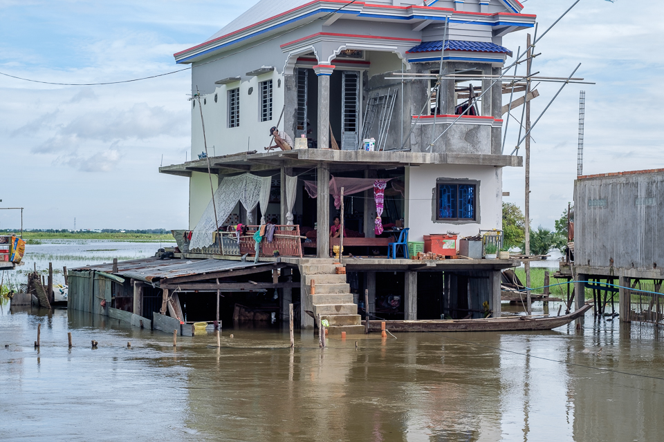 Houses are under the serge of water from the daily downpours here in Cambodia.