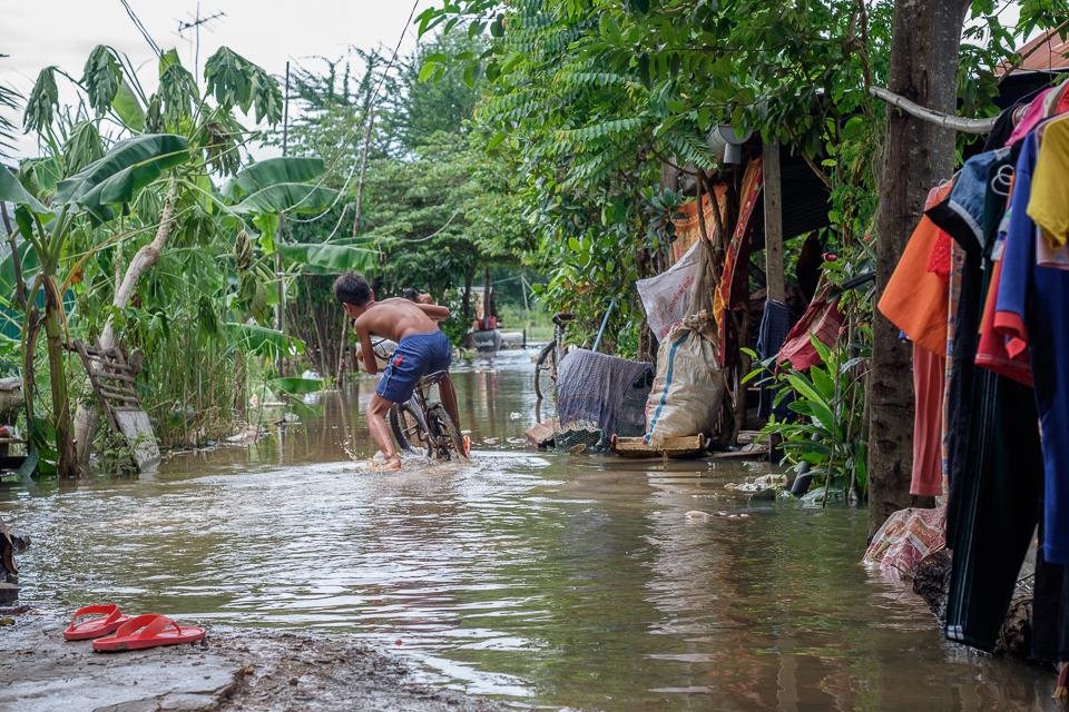 Boy in a flooded village.