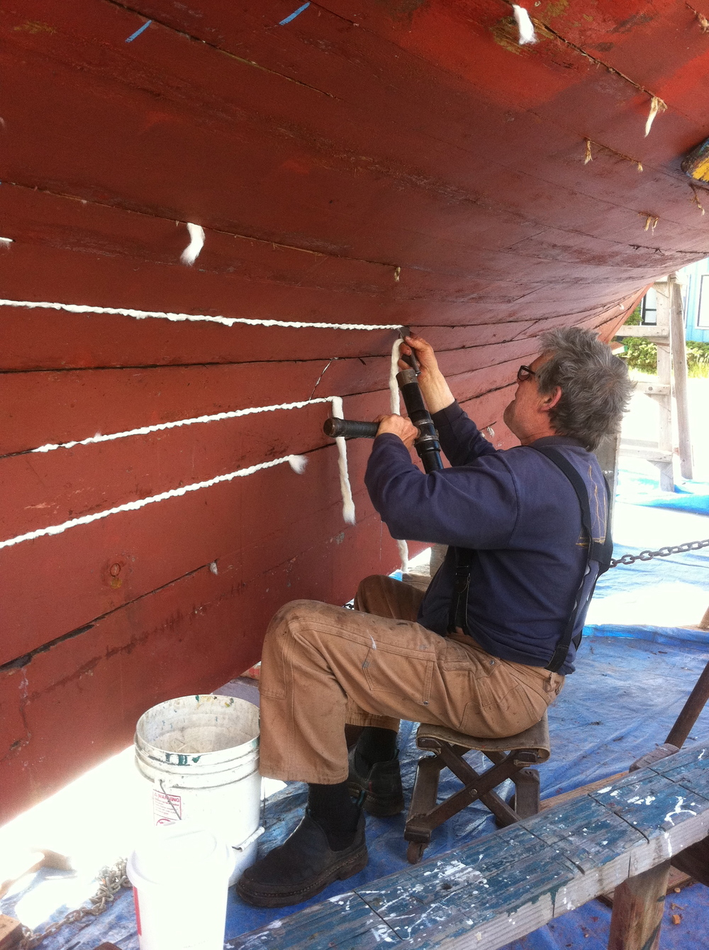 "Eric ""Moose"" Wilson caulking Pax in 2011. One of thirty Port Townsend marine trades people who worked on Pax."