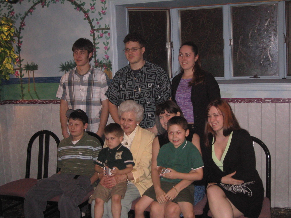 Grandma at 80 with her Grandkids (minus my brother) and her Great-Grandkids