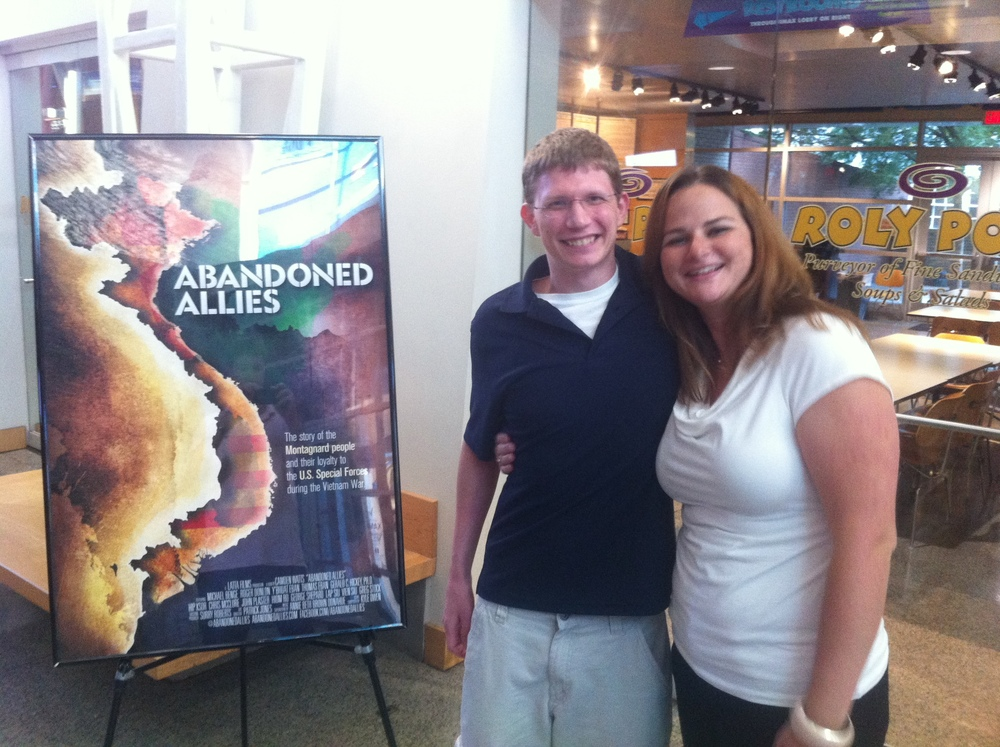 Kyle Owen (Composer) +  Camden Watts  (Producer/Director) in front of the  Abandoned Allies  movie poster created by  Patrick Jones.