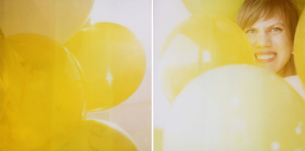 My husband bought me 30 balloons for my birthday. So I took a polaroid self portrait with them surrounding me. :)