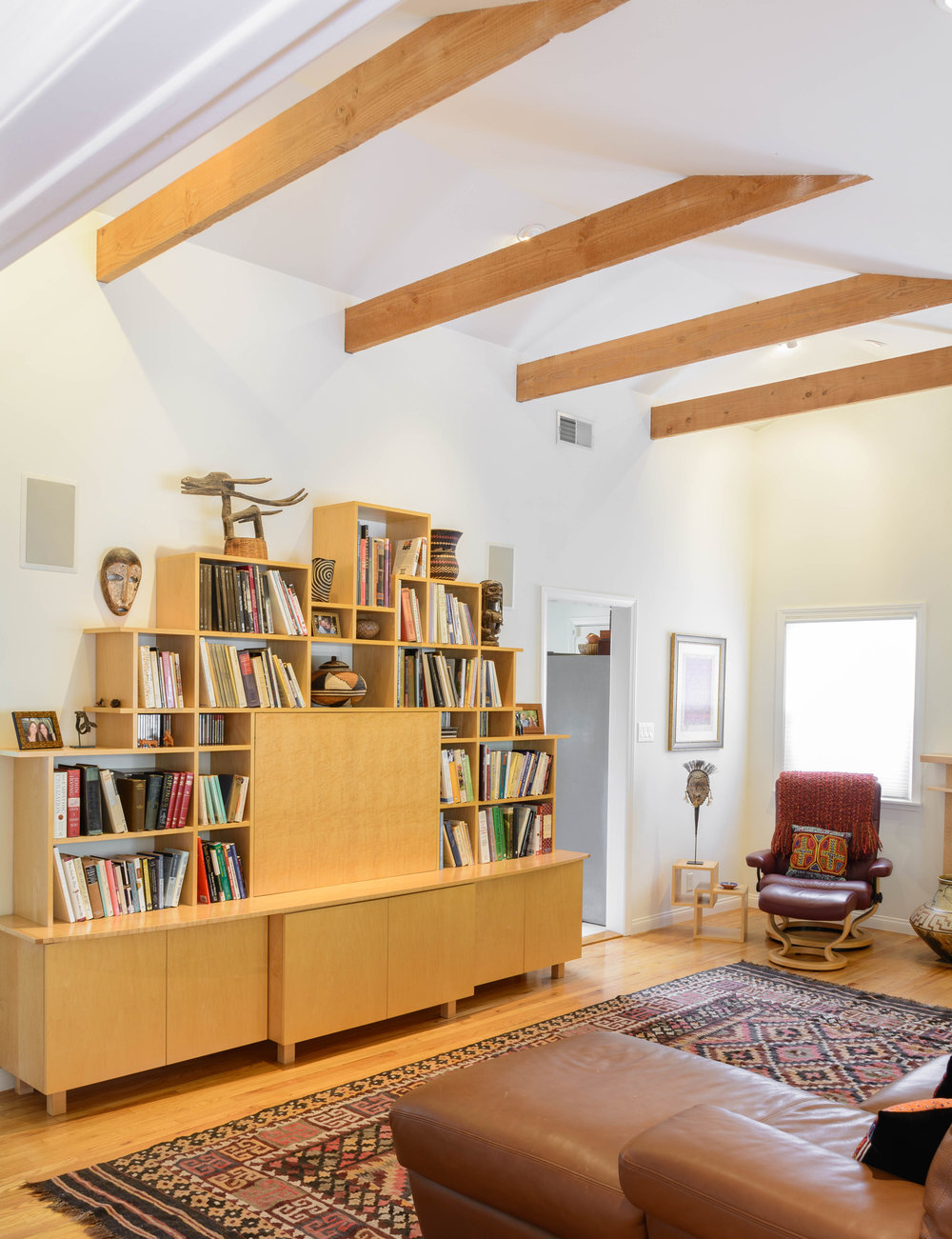 Living room built-in maple entertainment center which also provides for the display of books and art pieces