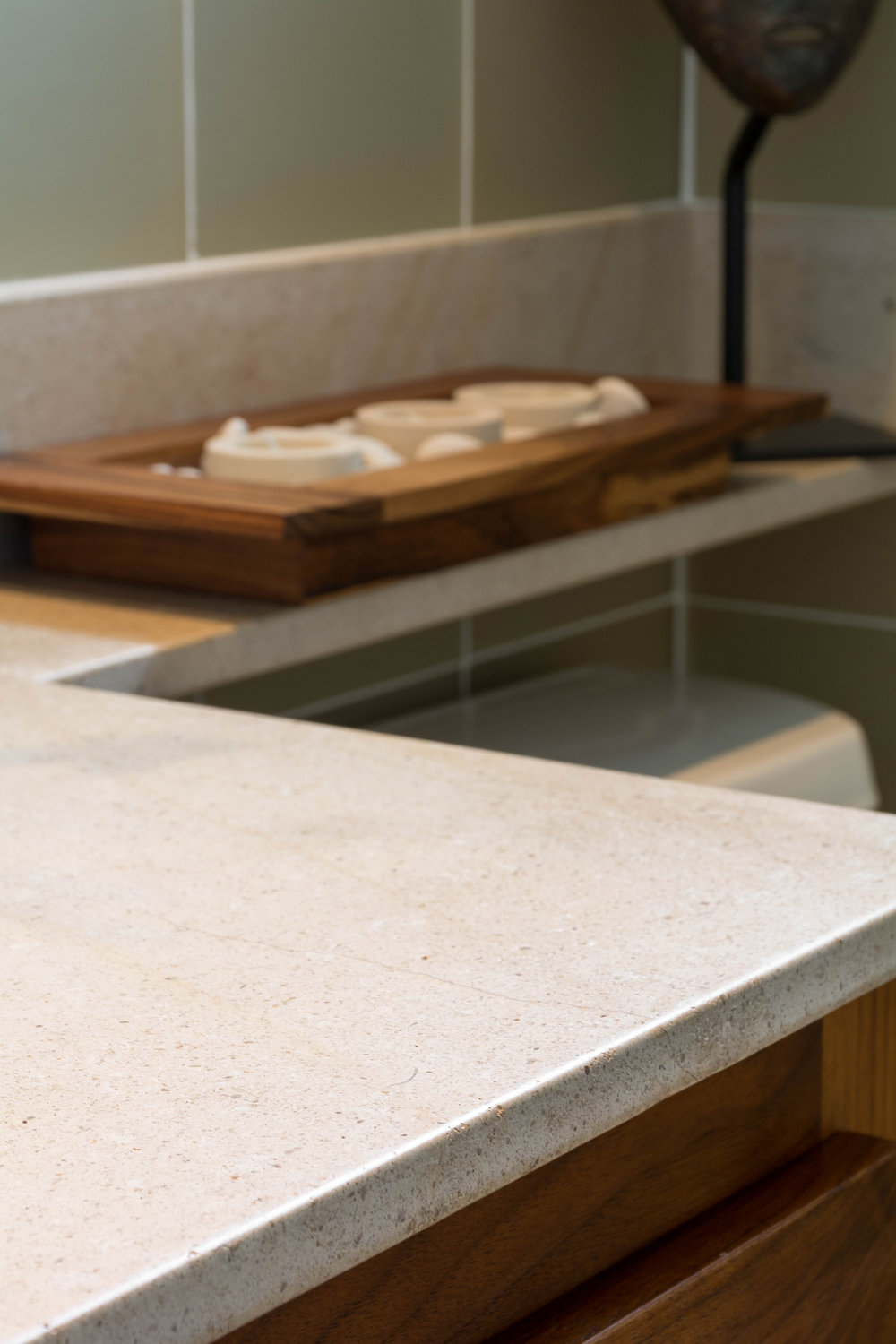 Limestone countertop with glass tile