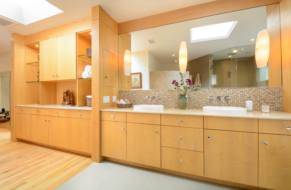 The built-in maple cabinetry transitions from master bedroom to closet to bathroom