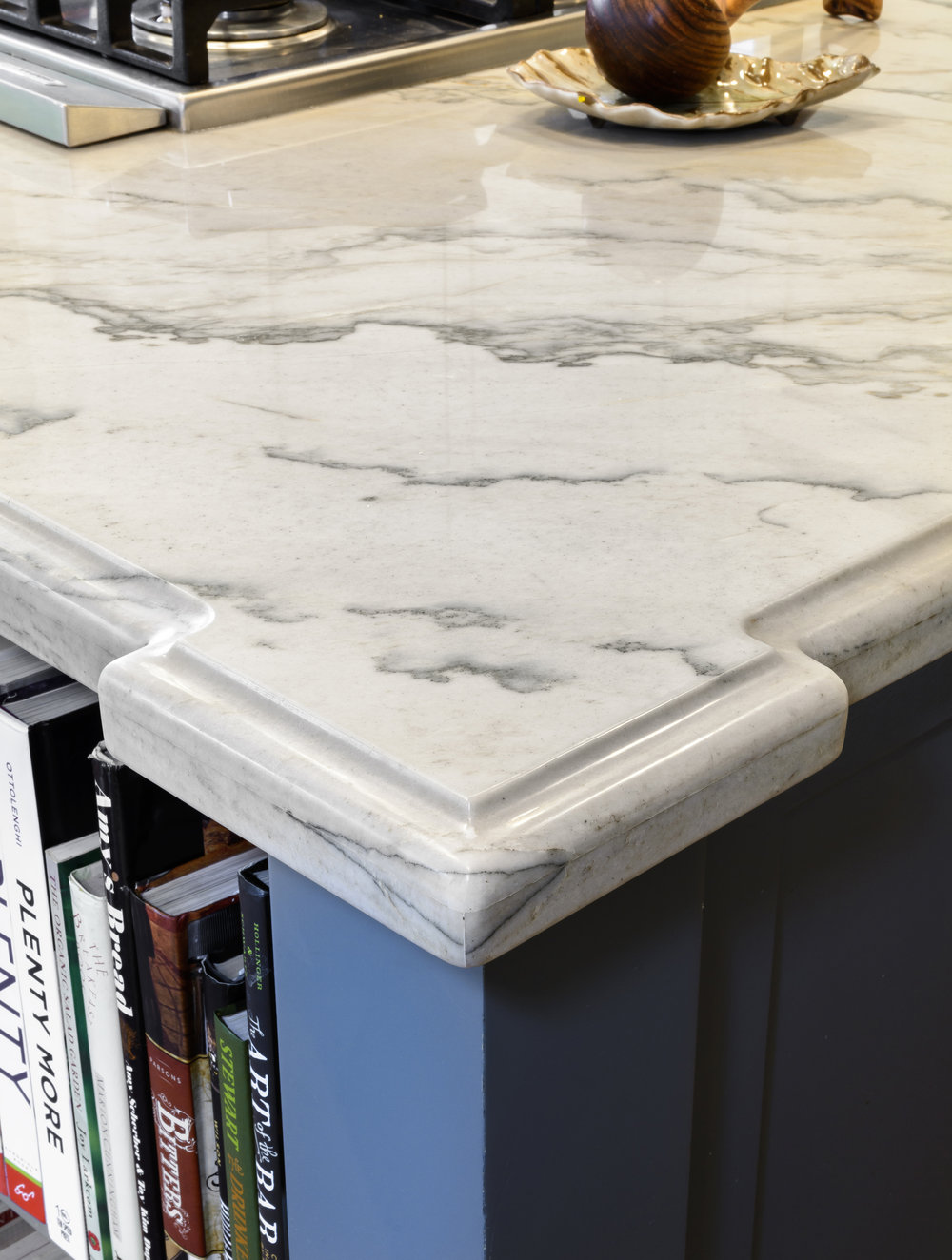 Kitchen island corner with marble countertop detail