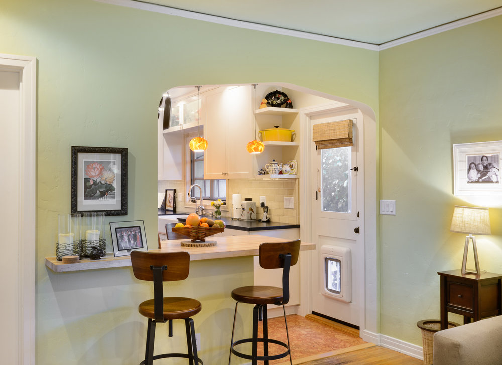 This small kitchen peninsula offering bar seating within an arched entryway creates an inviting space