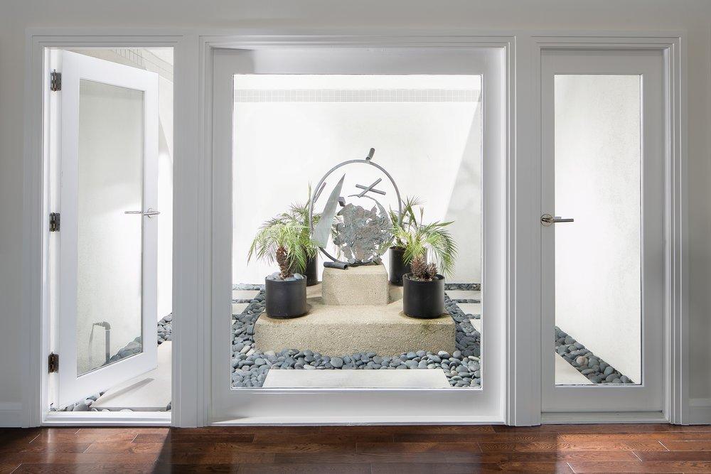 Post-Modern-Update-Dining-Room-Courtyard-Doors-Picture-Window.jpg
