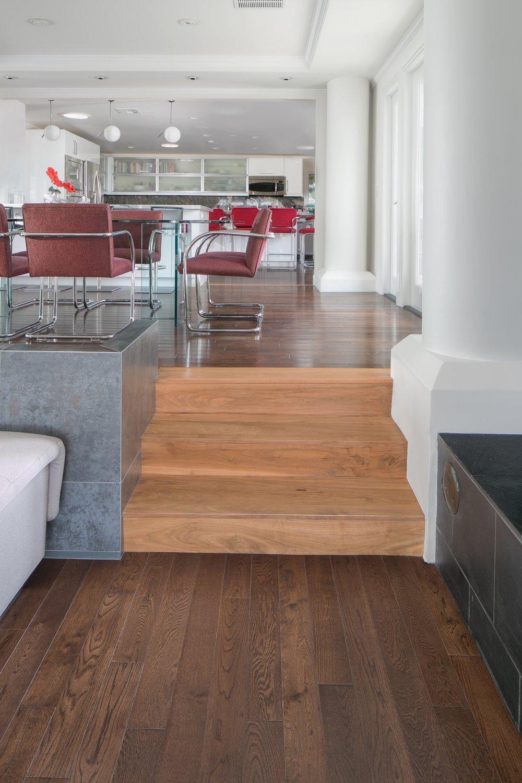 Post-Modern-Update-Walnut-Stair-Tile-Wall-Chestnut-Wood-Floor-Living-Room-Dining.jpg
