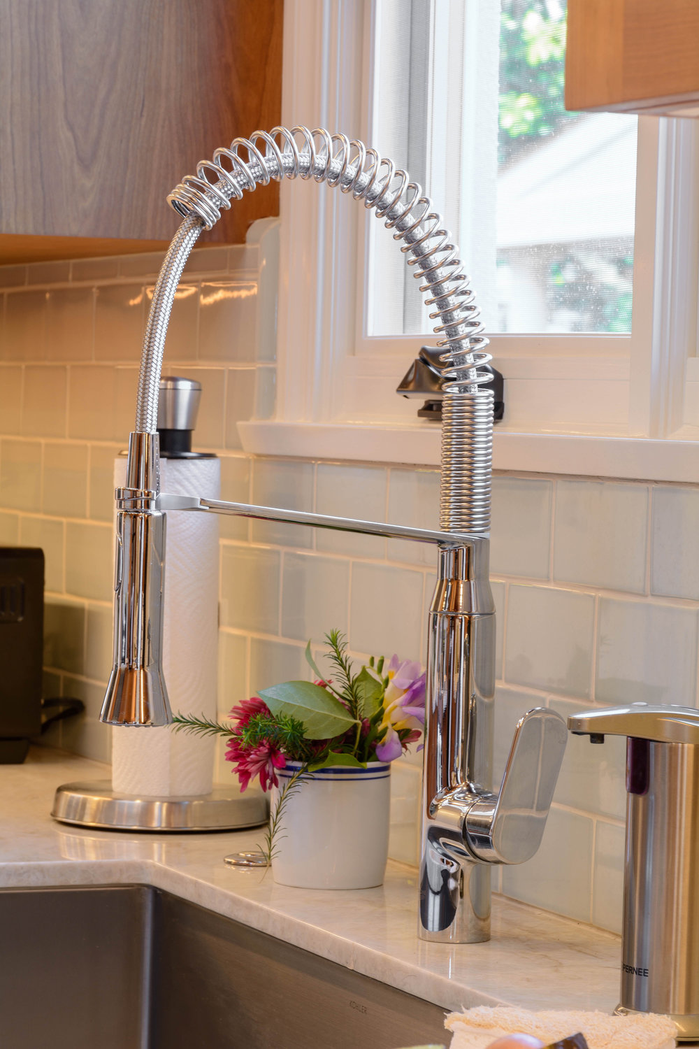 Commercial chrome kitchen faucet assorted with a stainless steel sink