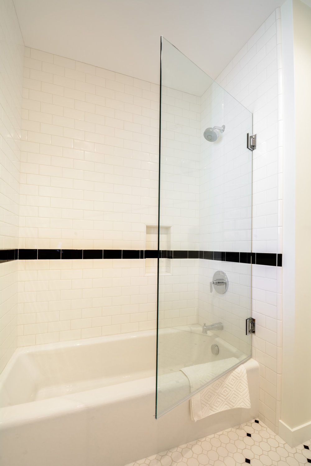Swing out glass door for the tub enclosure