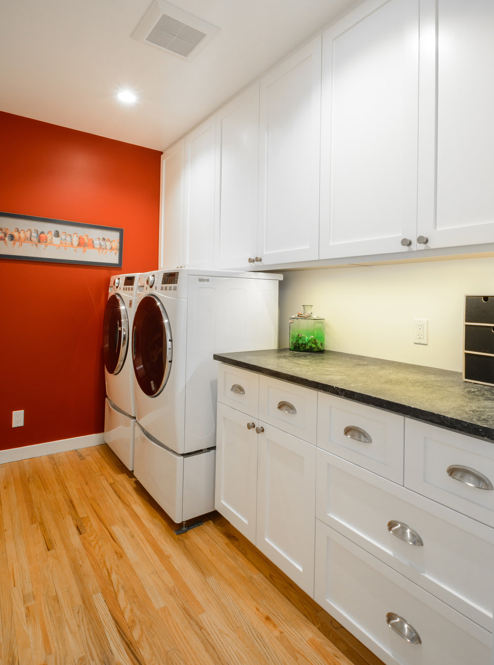 Laundry room with withe Shaker cabinets and soapstone countertop