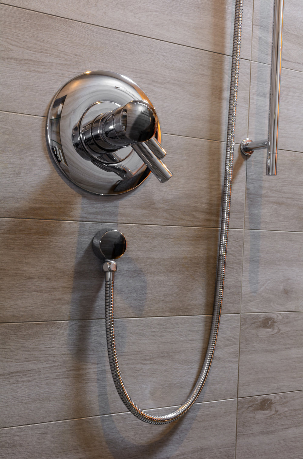 Modern shower valve with hand held fixture