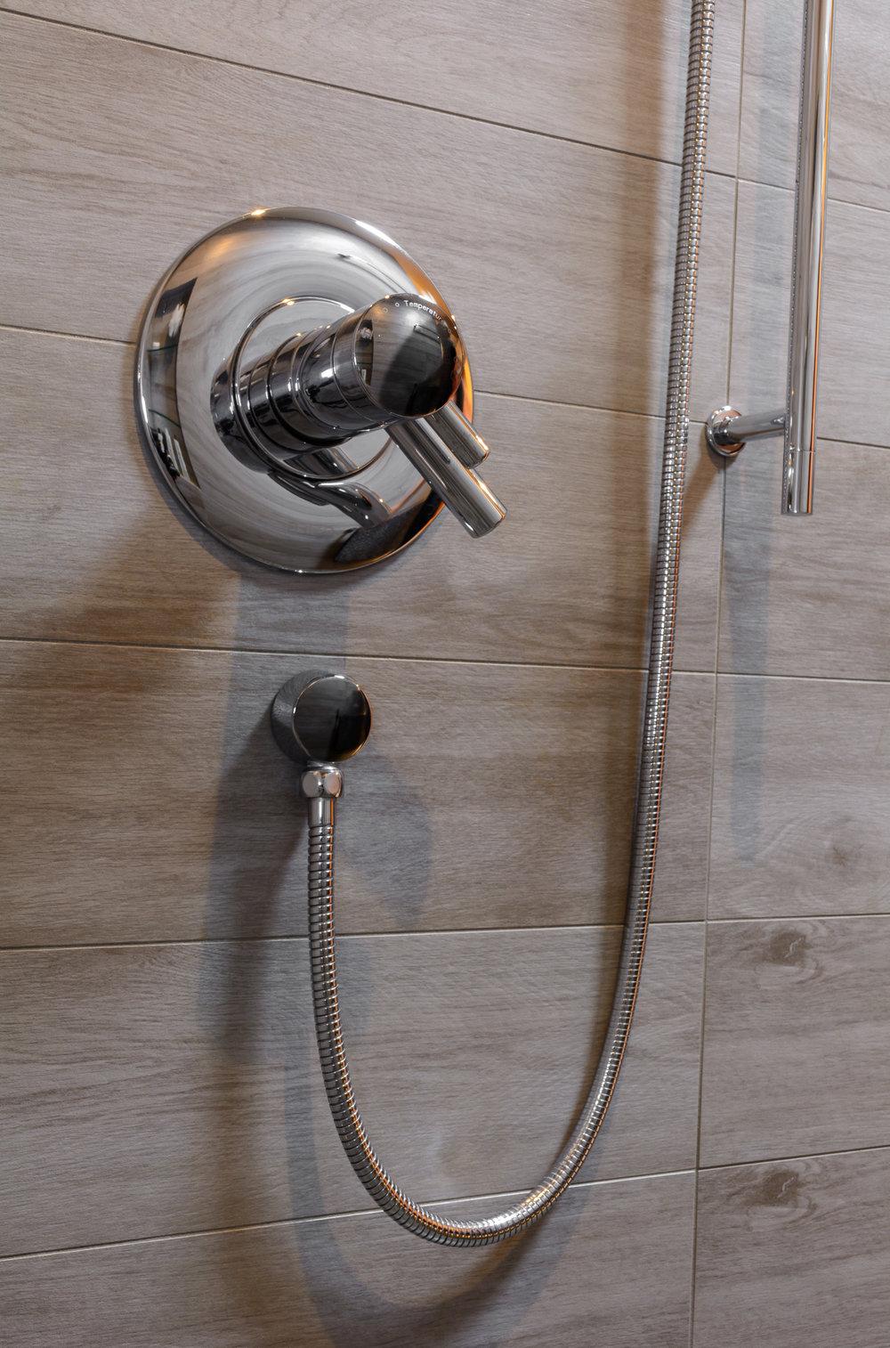 Modern shower valve with hand held fixture