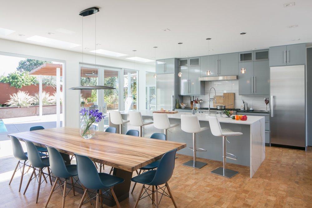 Mid-Century-Modern-Kitchen-Dining-Table-Island-Waterfall-White-Slab-Gray-Cabinet-Wall.jpg