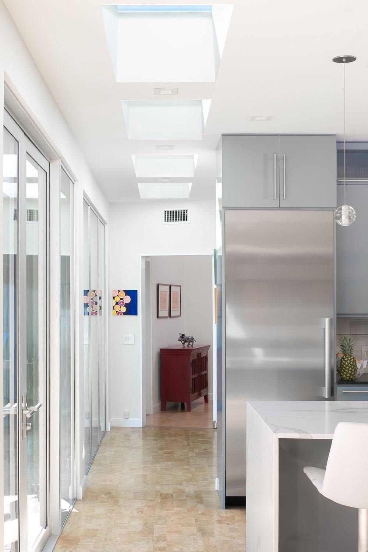 Mid-Century-Modern-Kitchen-Island-Refrigerator-Skylights-Cork-Floor.jpg