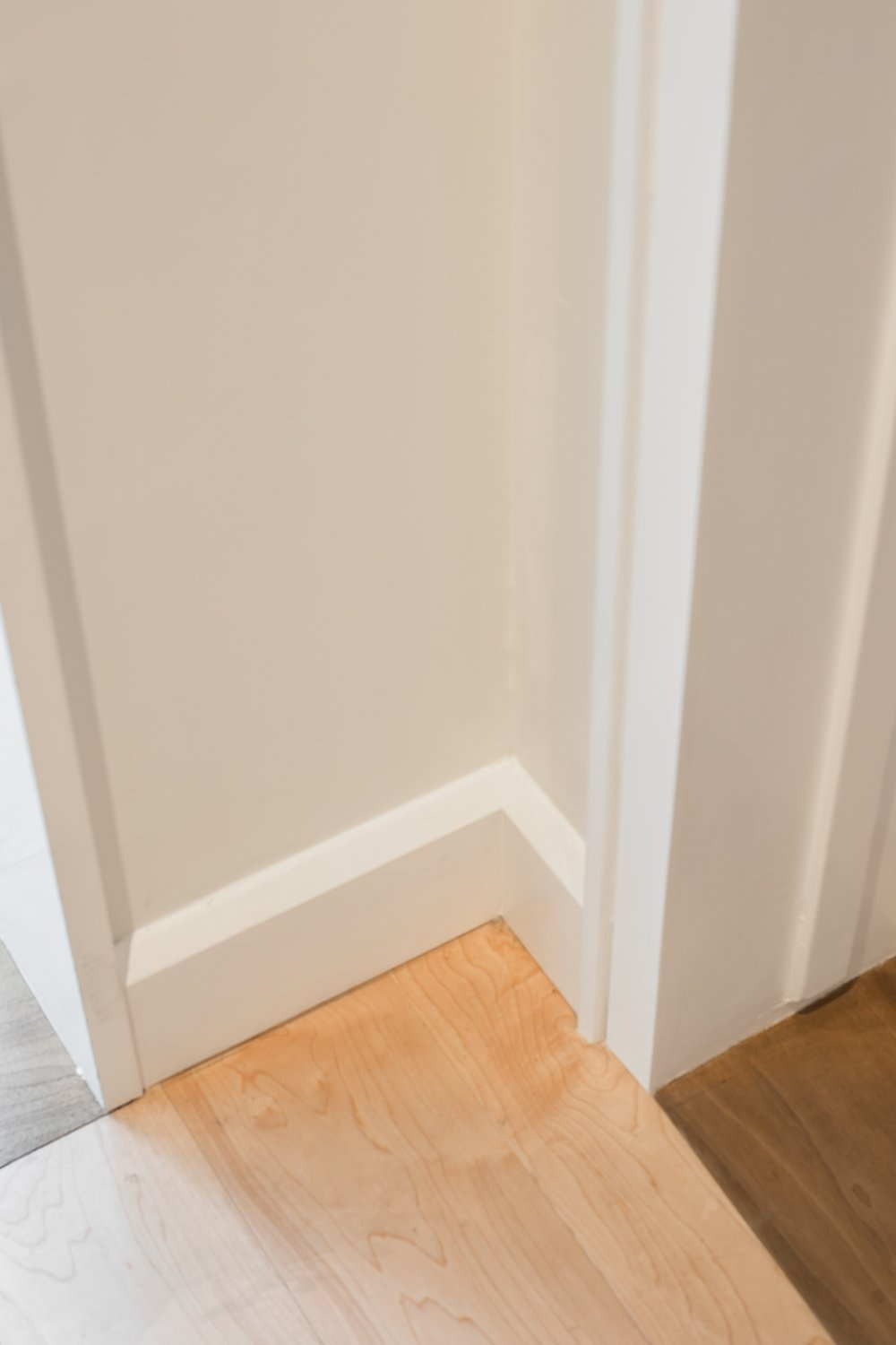 Walnut threshold, maple floor and custom casing and baseboards