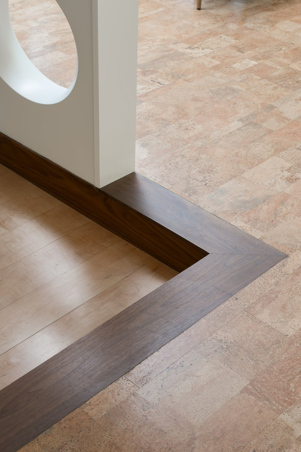 Walnut step between maple and cork floor for this mid-century modern remodel