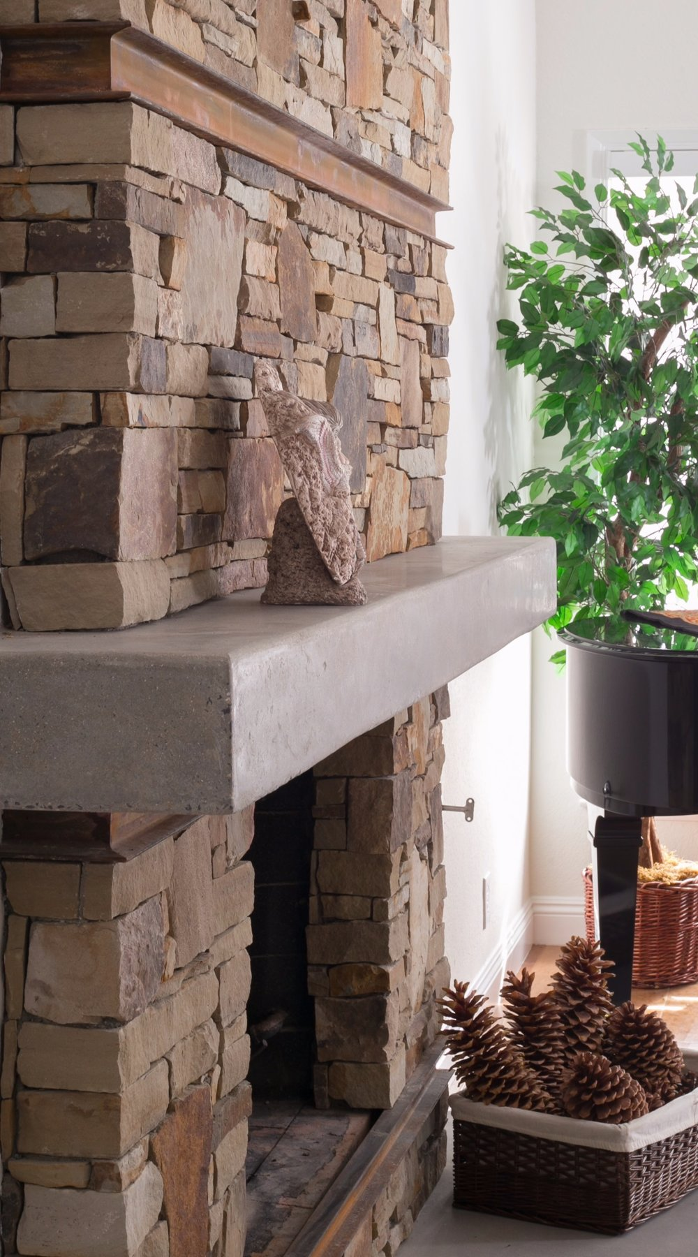 Transitional-Space-Fireplace-Stacked-Stone-Rusted-Chanels-Polished-Concrete-Mantel.jpg