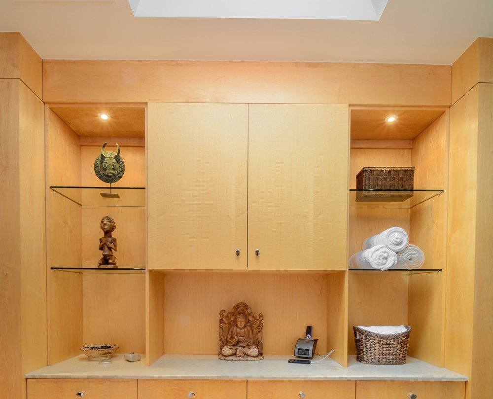 Built in custom cabinetrywith recessed lights