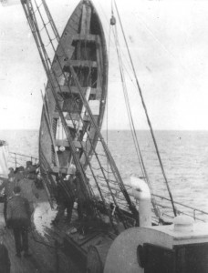 A lifeboat hoisted aboard  Carpathia  is drained of sea water