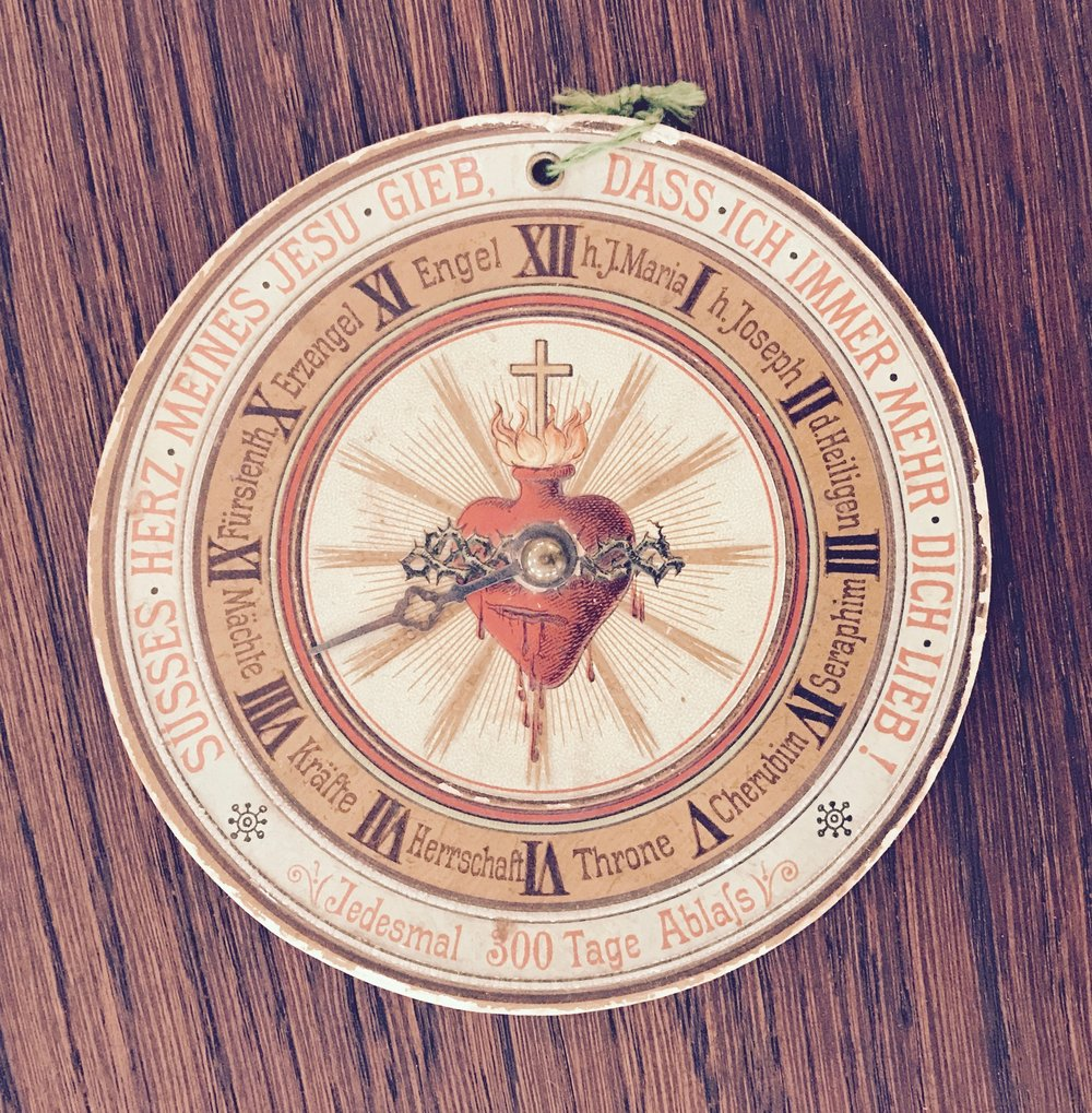 printed charm with the 10 angelic orders and a clock hand to direct one's prayer