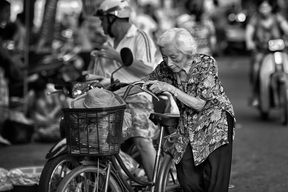 old woman buying at the market in the Old Quarter in Hanoi's capital