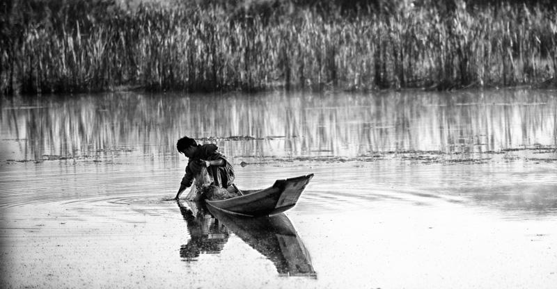 Canoe with fisherman in Myanmar
