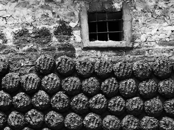 charcoal patties at a wall