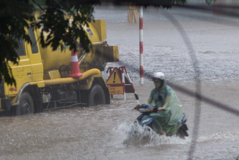 A biker passing a drainage unit
