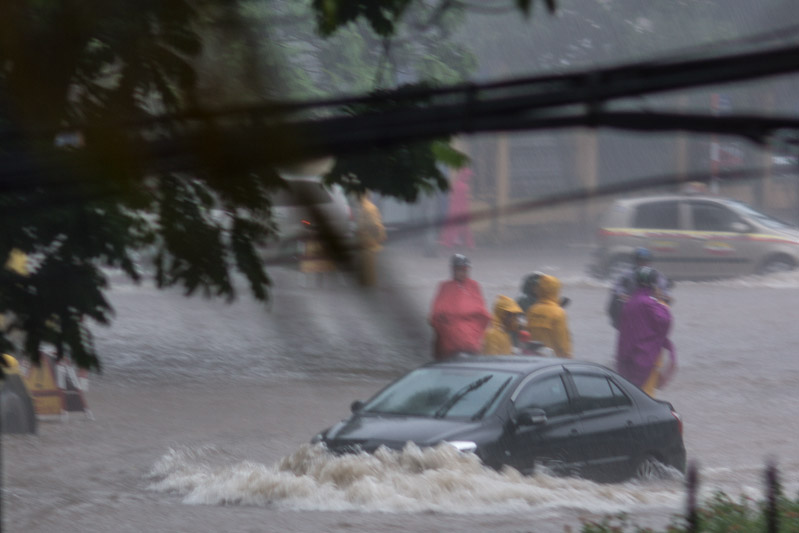 a car passing the flooded area