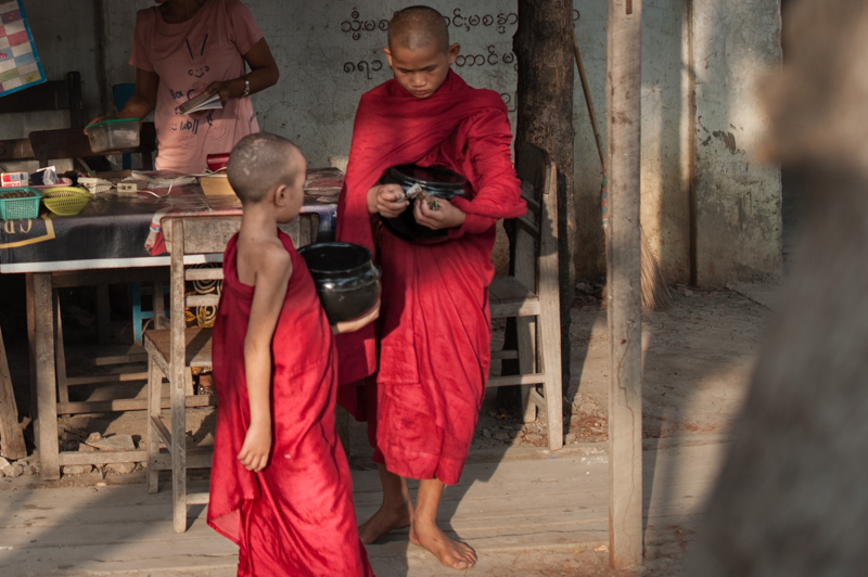 Early morning monks collecting food, money and other gifts
