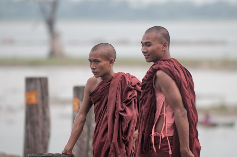 two young monks posing on U Bein bridge