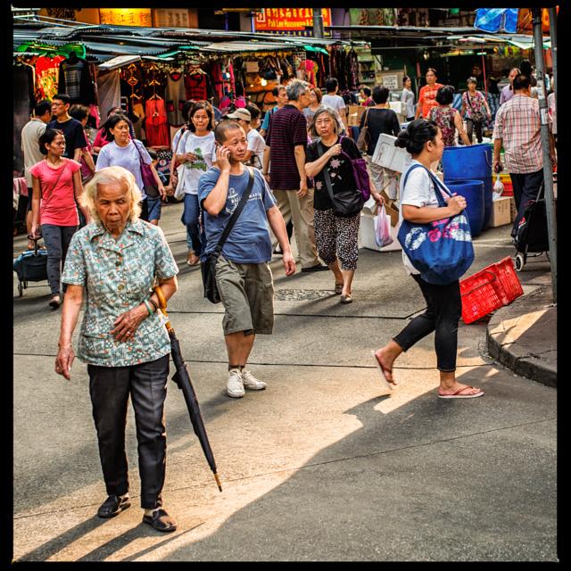 Bustling street near a wet market in North Point