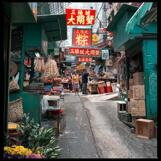 typical Hong Kong alley with a bustling wet market