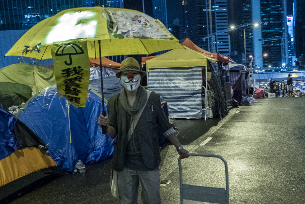 Yellow Umbrella and occupy mask - symbols of the peaceful revolution