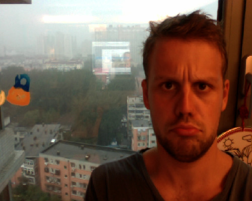 Stupid thunderstorms in Beijing mean I can't go out because my stupid leg wound can't get wet, especially not when you consider Beijing water/rain is basically airborne sewerage.   Shit gets meta when you look at the reflection of my taking the photo - INCEPTION. IT'S A LAYER IN A LAYER.