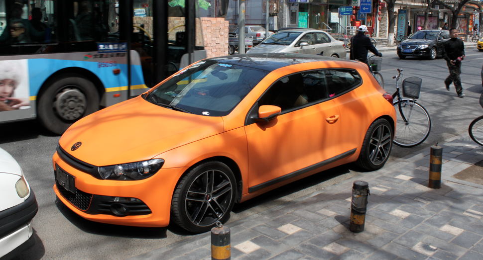 What, you've never seen a matte orange VW Sorocco GTI before? Notice the lack of number plates…if you're rich and important, you don't need em.