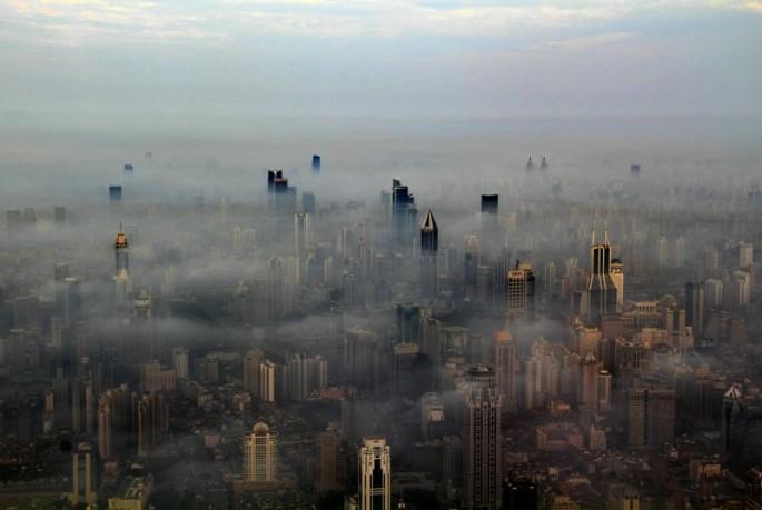 Photographer Wei Gensheng from a crane high above Pudong, Shanghai.