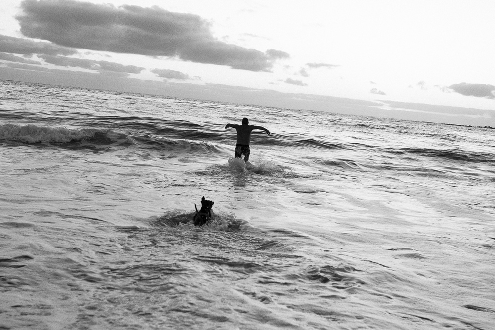 Coogee local goes for his daily swim with his Dog.