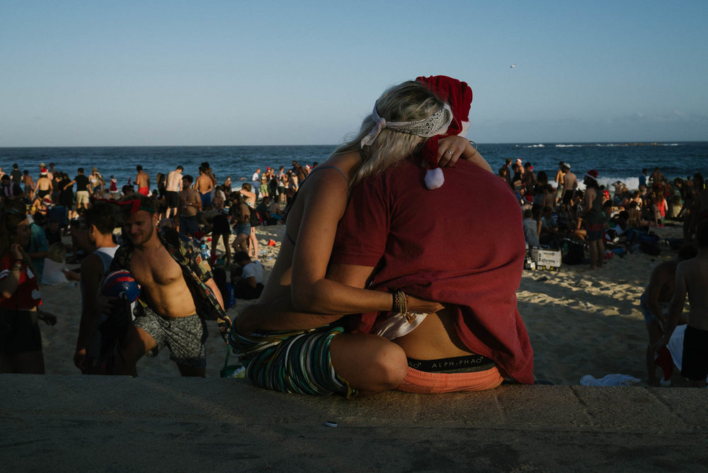 A couple have a quite moment at Coogee beach.