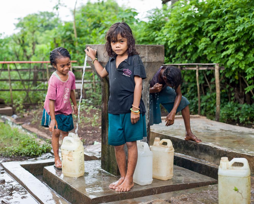 Little girls fetching water