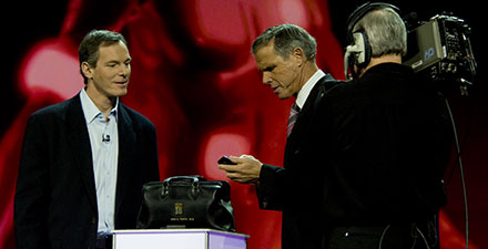 Paul Jacobs (left) and Eric Topol (right) demo Mobile Baby at CES