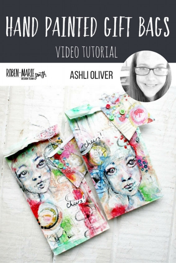 Design Team member Ashli Oliver is sharing with us some beautiful hand painted gift bags. Follow along with her video tutorial as she creates something which is sure to make you the hit of the party! She uses Art Pops™ and Paperbag Studio Stamps to create this gorgeous piece of Art! @robenmarie @soaphousemama #robenmarie #robenmariedesignteam #paperbagstudios #artpops #mixedmedia #diy